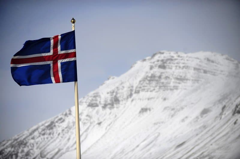 TO GO WITH AFP STORY :ICELAND-VOLCANO-ERUPTION-KATLA-FOCUS An Icelandic flag flies over Vik, a village sitting at the base of the Myrdalsjokull glacier, which is part of the ice cap sealing the Katla volcano, in Vik, on April 22, 2010. Katla, a volcano 10 times more powerful than neighbour Eyjafjallajökull, which erupted last week and impacted air traffic worldwide, has erupted in intervals of 40-80 years and its last eruption was in 1918. The village of Vik sits between the two main lava and glacial flood routes and has set up evacuation plans to abandon the village promptly if Katla erupts. AFP PHOTO/Emmanuel Dunand (Photo credit should read EMMANUEL DUNAND/AFP/Getty Images)