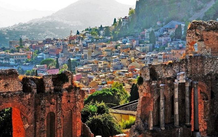 City view of ancient buildings in Italy and mountains