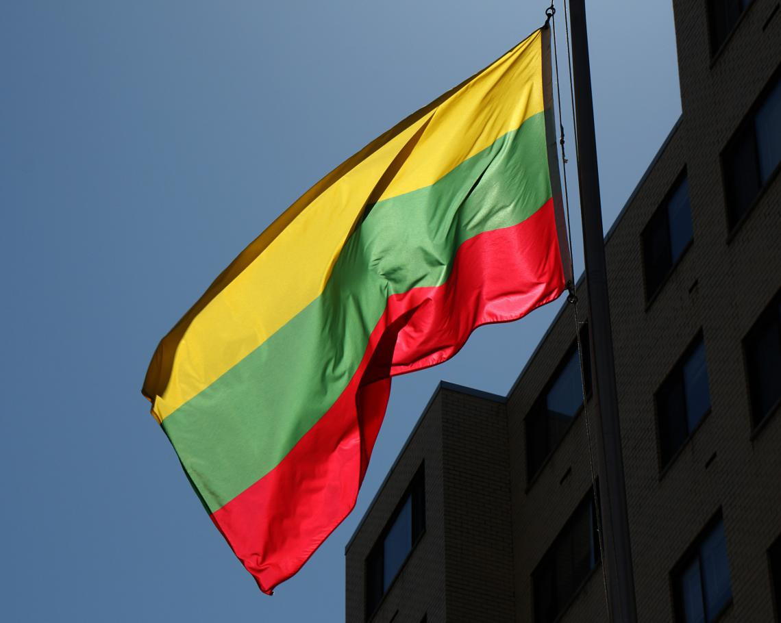 Lithuanian flag in front of a building