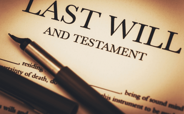 Last will and testament document ready for signing with pen.