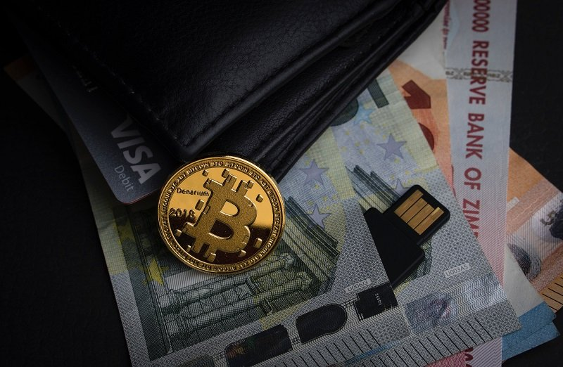 Wallet with credit card, cash money, bitcoin and a flash drive
