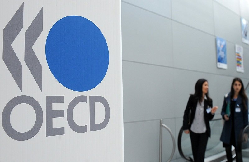 The Organisation of Economic Cooperation and Development (OECD) logo is seen at the company's headquarters.