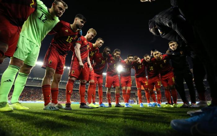 Belgium football squad grouping for a talk.