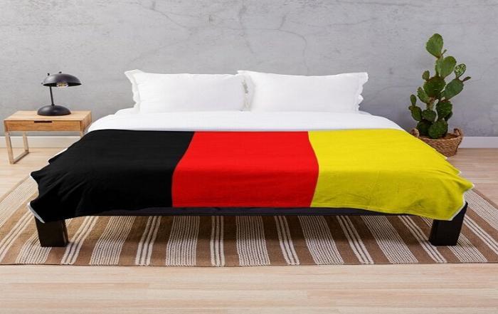 Belgium flag on a bed sheet.